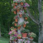 Suport de flori din trunchi de copac