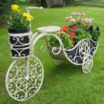 Suport de flori in forma de caleasca