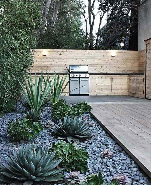 Amenajare gradina exotica cu pietre de rau